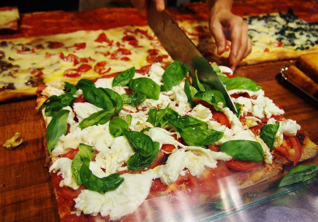 Take a bite off a square Pizza in Rome. Image Source: www.sankles.com