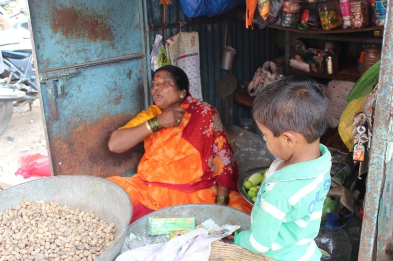 Sushila Tadake owns a small roadside shop. selling fruits, peanuts and grocery items. She recently paid her first installment of the loan.  Image Source: rangde.org