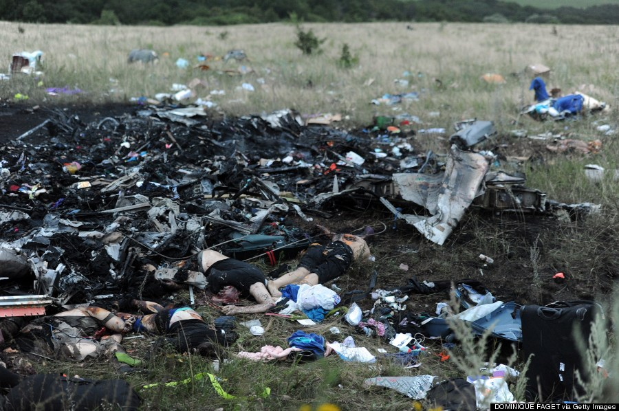 A picture taken on July 17, 2014 shows bodies amongst the wreckages of the malaysian airliner carrying 295 people from Amsterdam to Kuala Lumpur after it crashed, near the town of Shaktarsk, in rebel-held east Ukraine.  Image Source: huffpost.com