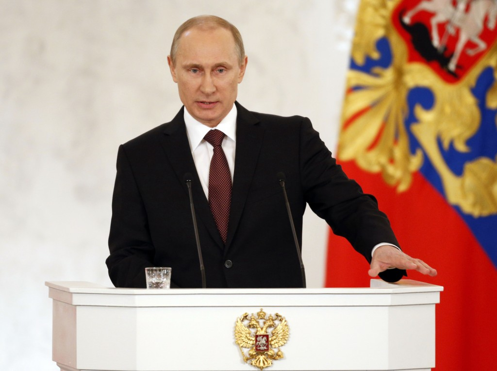 Russia's President Vladimir Putin addresses the Federation Council in Moscow's Kremlin on Tuesday, March 18, 2014. Putin defended Russia?s move to annex Crimea, saying that the rights of ethnic Russians have been abused by the Ukrainian government. Image Source: www.aol.com