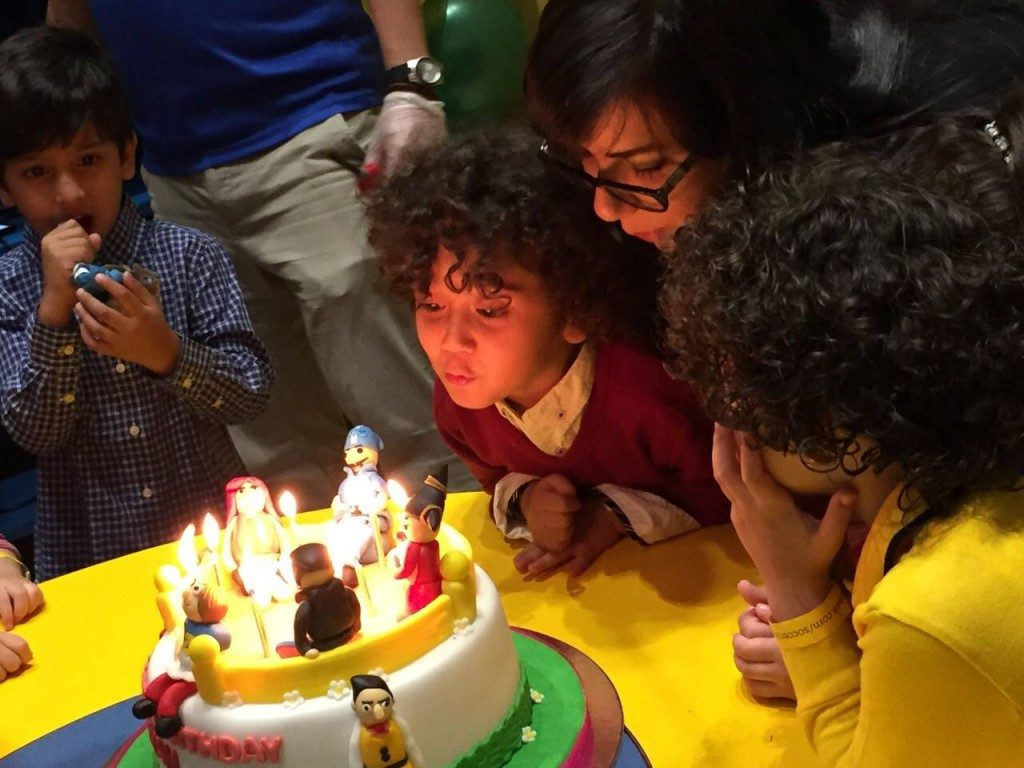 Writer Shireen with her son Eyan blowing out the candles.