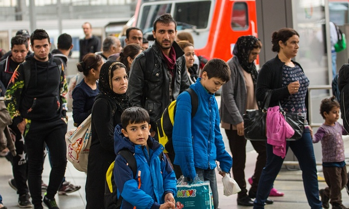 Migrants are brought through the central station in Munich to the registration area. Image Courtesy The Guardian. Photograph: Reflektierter-Bengel/Demotix/Corbis